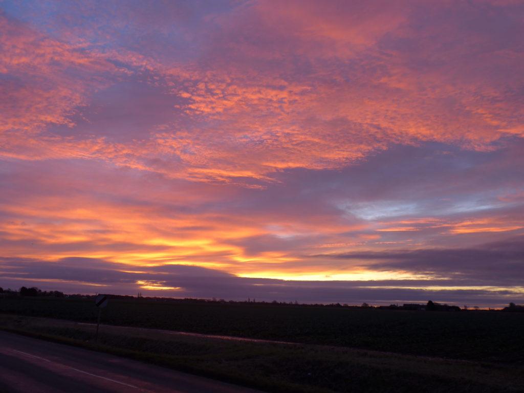 A photograph of a purple and orange sunrise