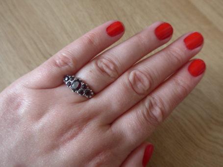 Red nail polish and vintage ring
