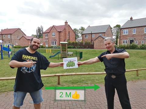Artist Warwick Eede and author Sav Sav celebrating the release of Tongue-tied Toad & Fluent Fly at a safe distance during the UK covid-19 lockdown